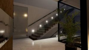Iluminación escalera Marble y Bamboo