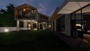 Vista nocturna del jardín interno
