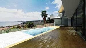 Terrase et piscine avec vue JC-House