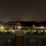 Vue nocturne du toit-jardin rendu