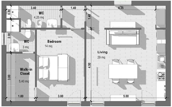 l image montre une vue en plan d'appartement T2, la forme de la pièces est rectangulaire, les espaces sont divisés par trois cloisons qui sépare les toilettes ,la chambre à coucher et le séjour