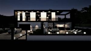 l'image représente un rendu de la construction d'une maison unifamiliale avec un effet de nuit et son éclairage extérieure réalisé avec Edificius le logiciel de conception architecturale