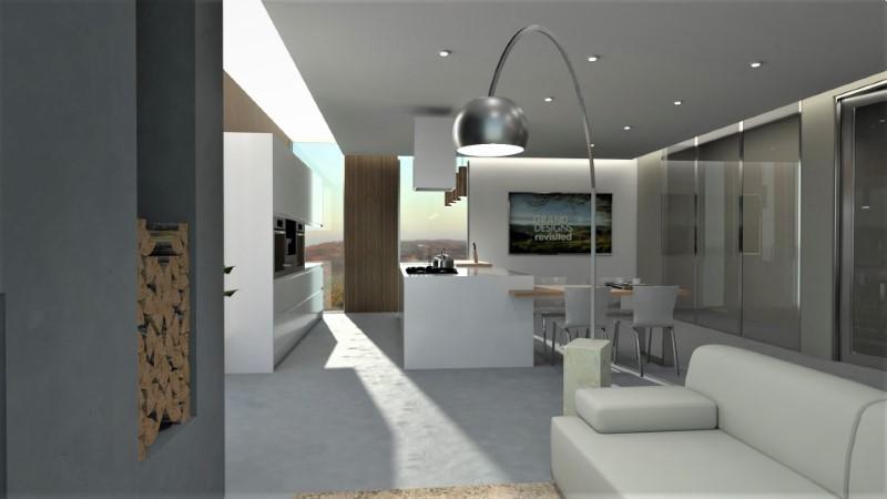 Un rendu d'une cuisine ouverte ou l'on voit une lampe moderne avec un canapé en premier plan et derrière la cuisine avec îlot