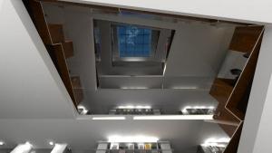 Une cage d'escalier avec une vue vers le haut ou l'on peut voire un toit vitré, issu de Edificius le logiciel de conception architecturale 3D BIM