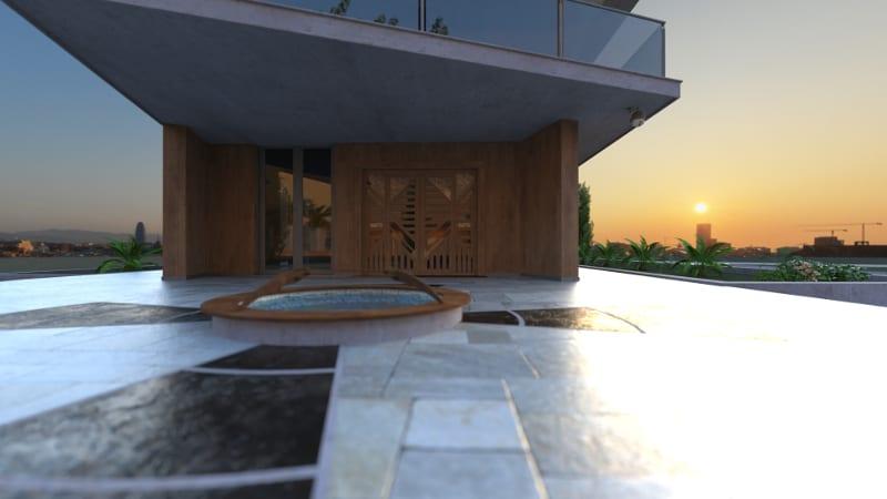 Une vue à ras de terre ou l'on voit un spot en premier plan dans le carrelage extérieur et sur l'arrière-plan une maison de construction moderne qui se plonge dans un coucher de soleil éblouissant.