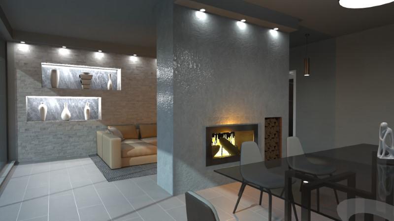 Le mur de la cheminée est placé au milieu du plan rectangulaire et divise le salon en deux:d'un côté la salle à manger et de l'autre la zone de détente.