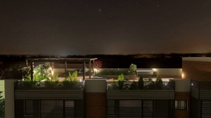 Vista noturna do teto jardim de Cuboid House