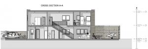 projeto 'L' de casas geminadas com pátio ou jardim – corte A-A