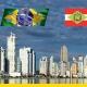 A imagem mostra o skyline da capital de Santa Catarina junto com a bandeira do estado e a escrita BIM com as cores da bandeira brasileira