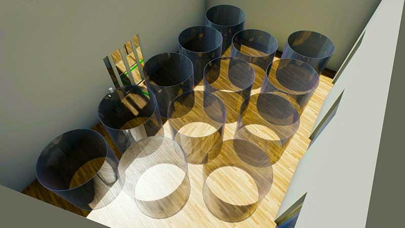 A imagem mostra uma sala com círculos para a verificacao do distanciamento interpessoal na reabertura das academias