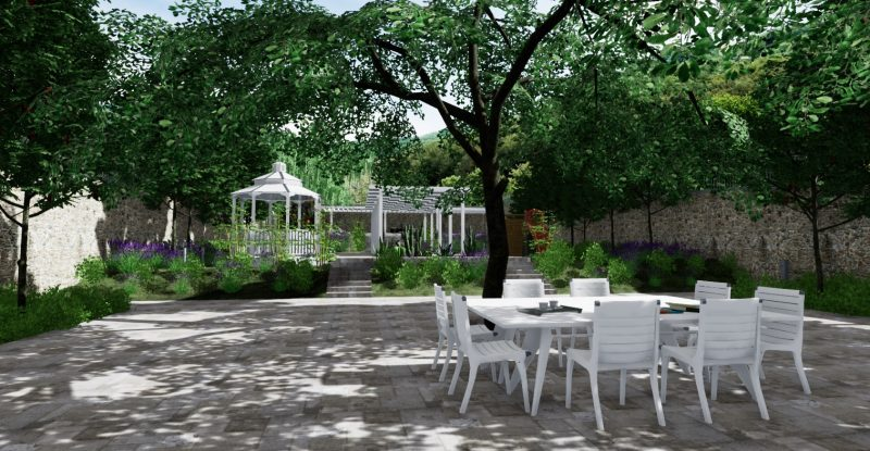 A imagem é um render realizado com Edificius. Ela mostra um jardim com uma mesa e algumas cadeiras em volta dela, algumas árvores e dois coretos.
