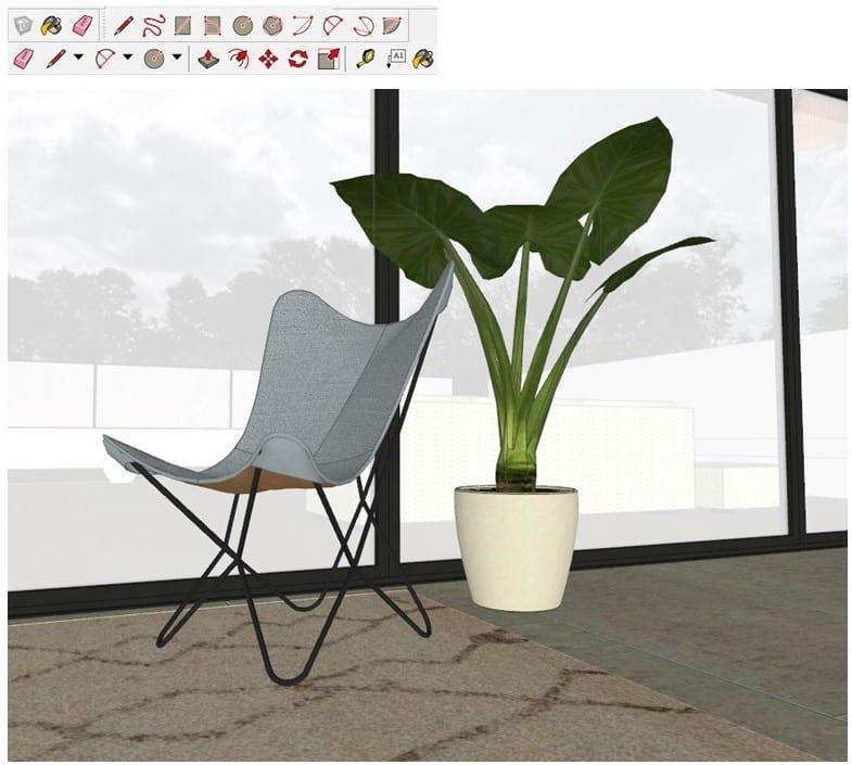 A imagem mostra uma renderização realista de uma cadeira cinza perto de uma planta em frente de uma parede de vidro.